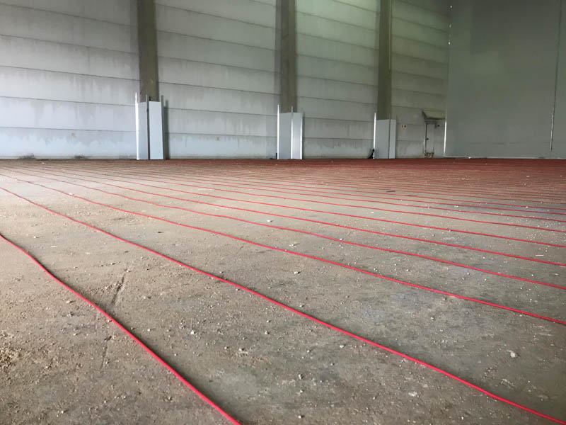 Preparations underway for an underfloor heating system. Photo by ©Precool Insulated Panels