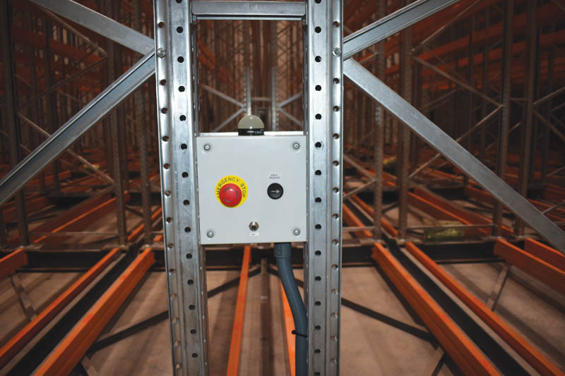 This mobile racking solution shows the aisle request button to gain access to the required aisle for picking. Image by Benjamin Brits