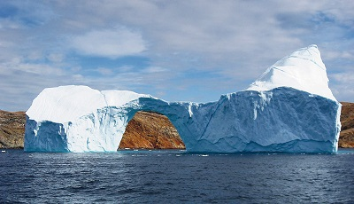 An iceberg is an example of frozen water and because it's lighter, it floats. Image credit: Wikimedia Commons